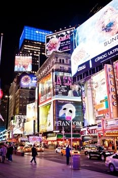 12059603-manhattan-new-york-city-usa--january-11-2011-times-square-featured-with-broadway-theaters-and-animat.jpg